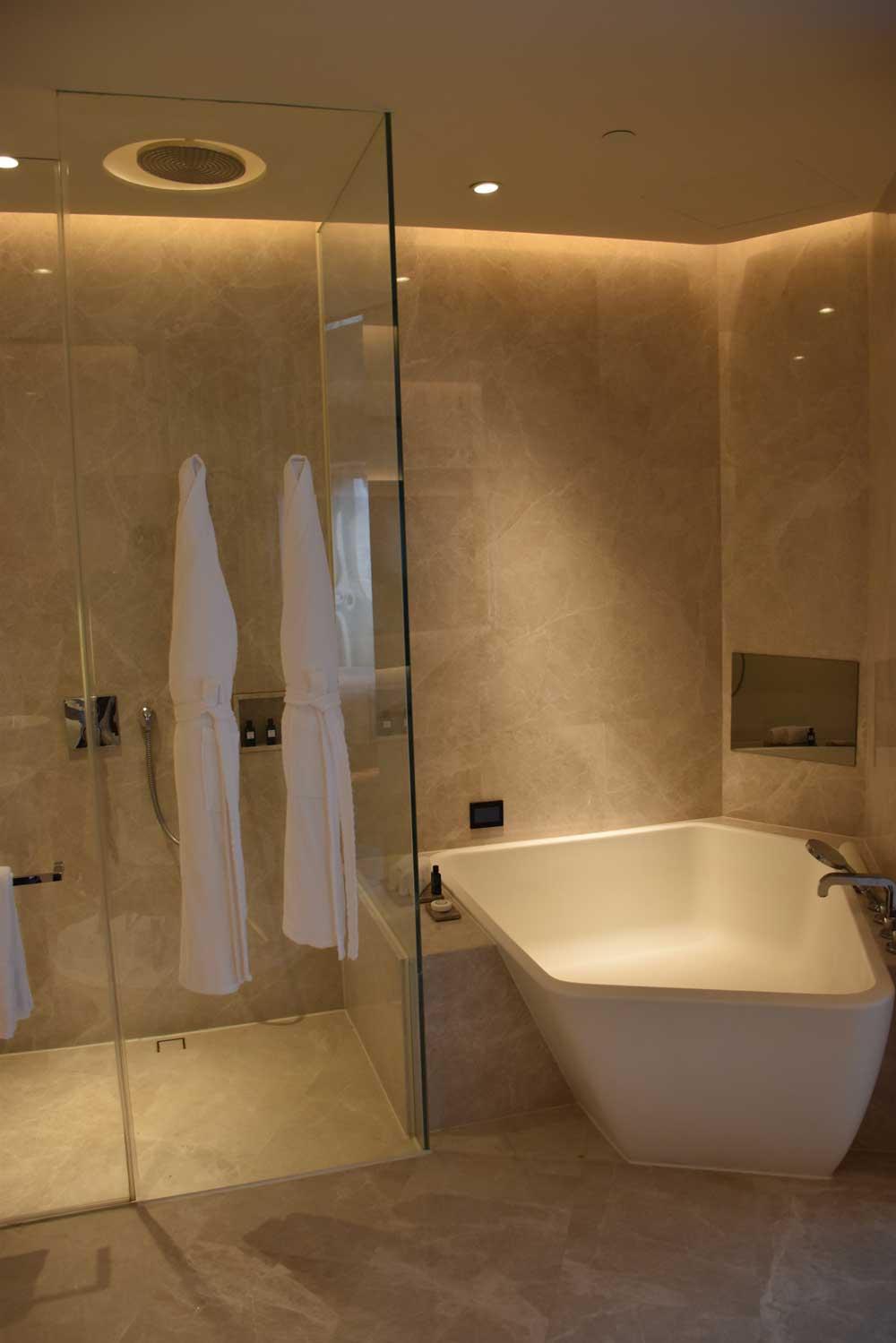 Morpheus Hotel Premier King shower and hot tub