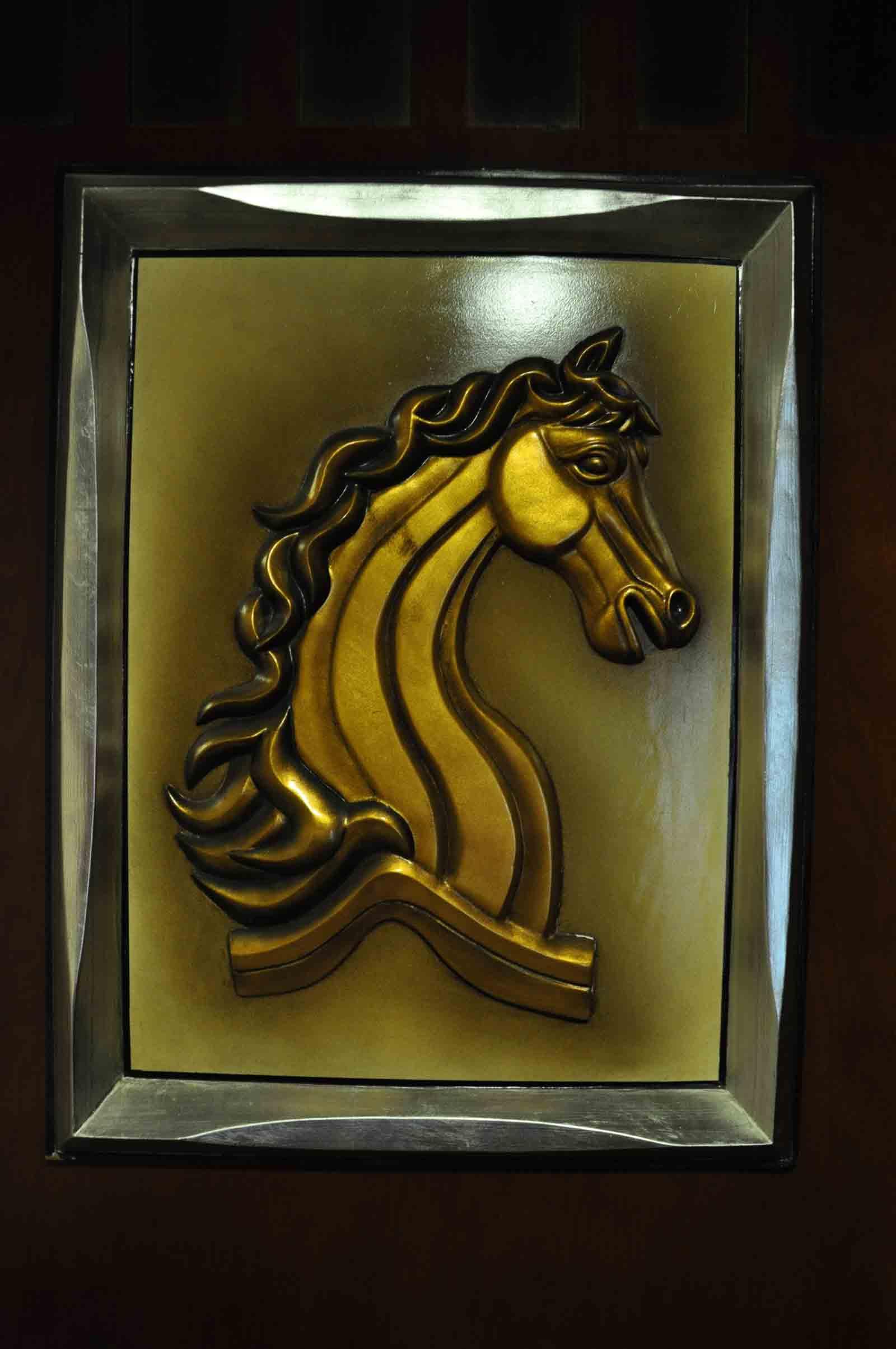 Grand Dragon Hotel horse insignia