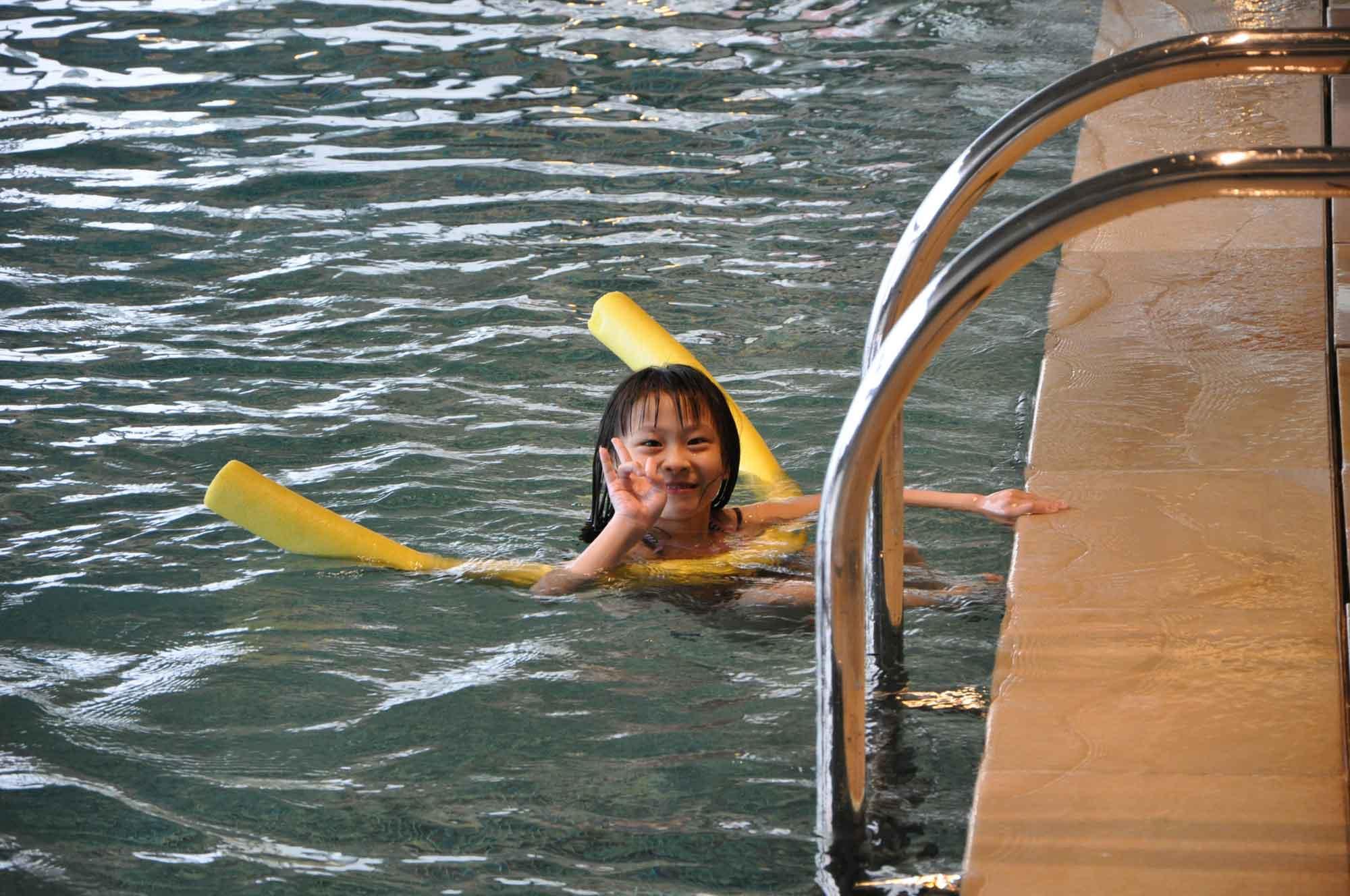 Altira Macau swimming pool and young model