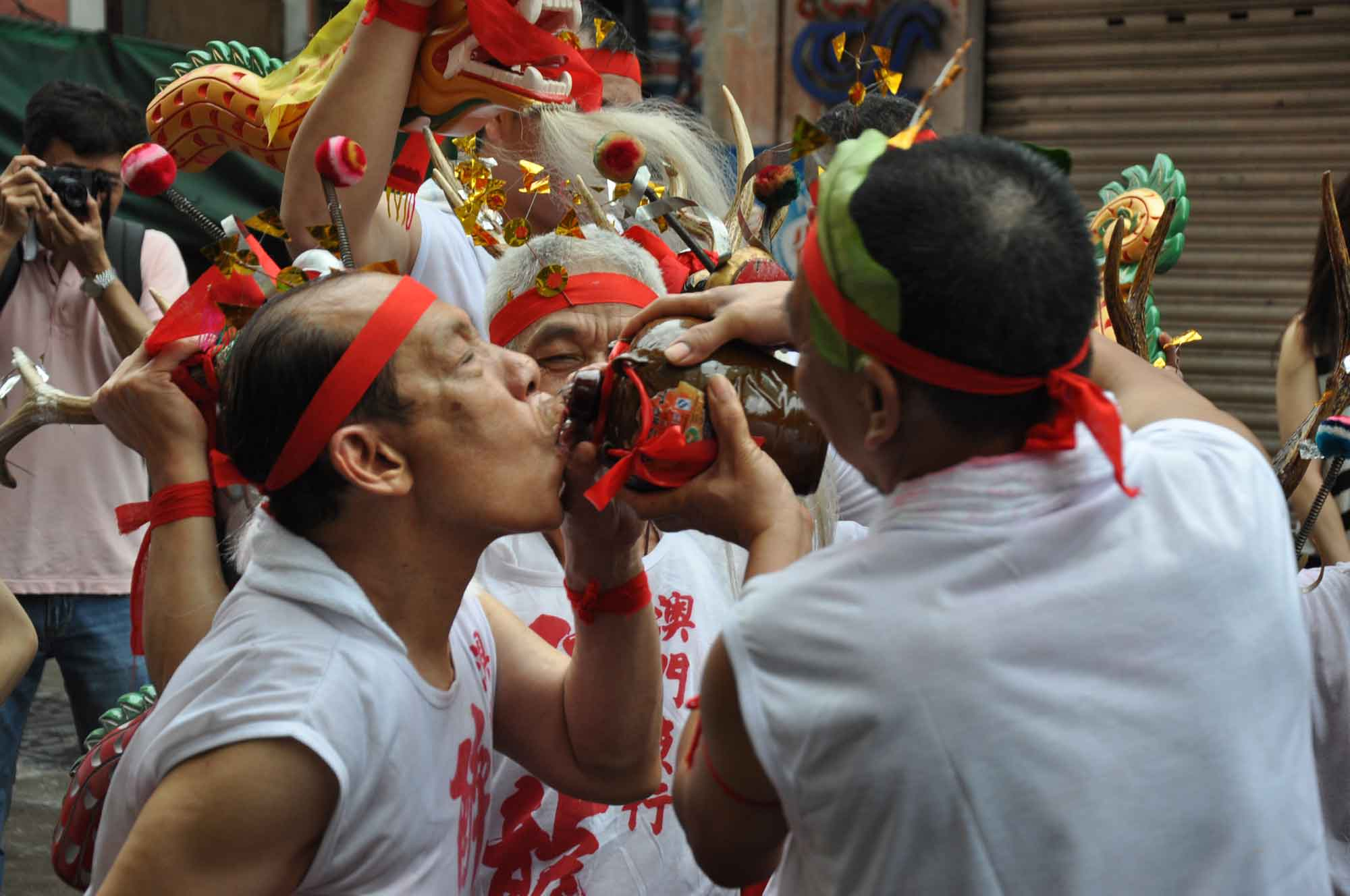 Feast of the Drunken Dragon Festival fishermen drinking from a flask