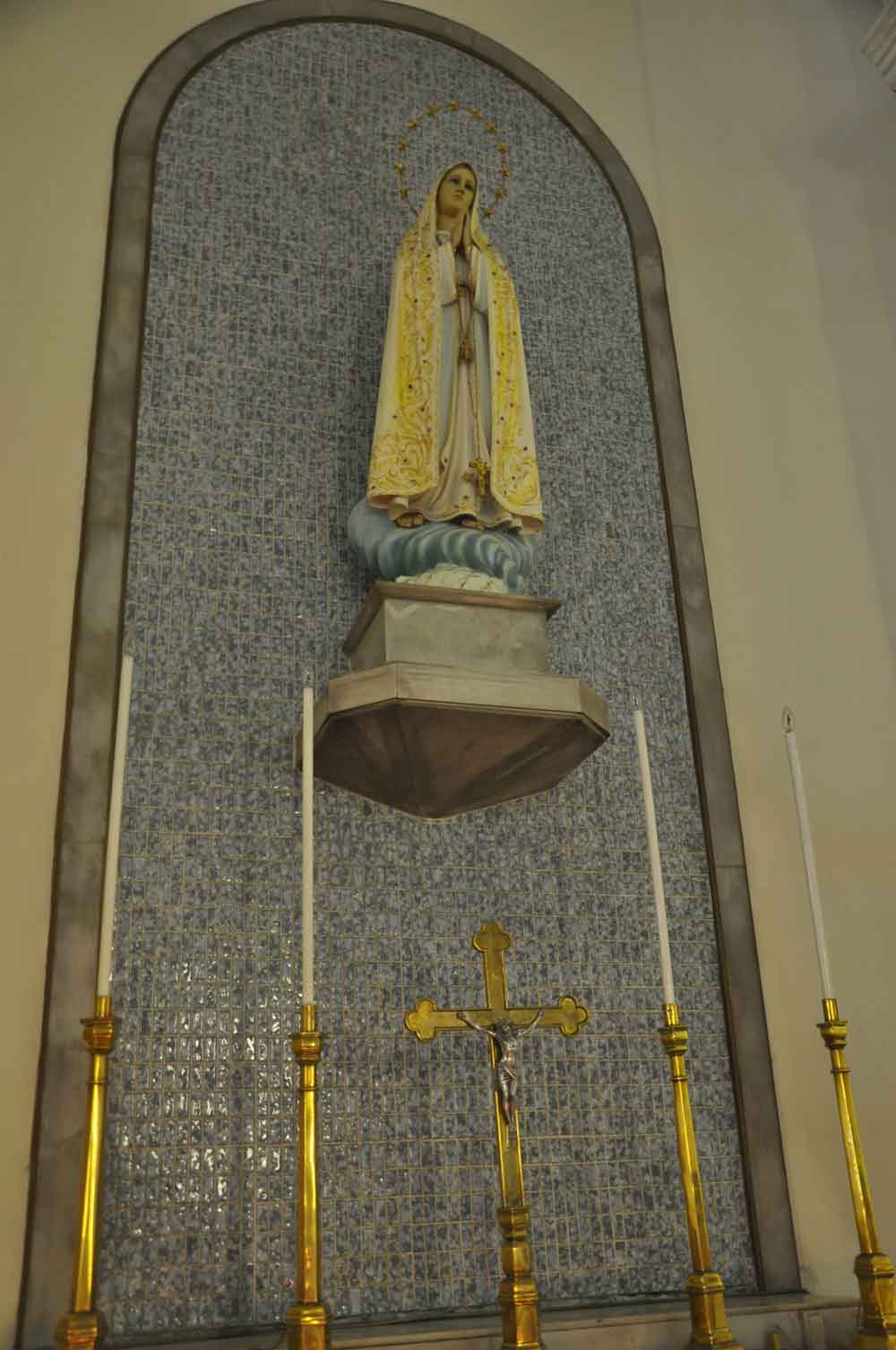 Virgin Mary with candles at St. Anthony's Church Macau