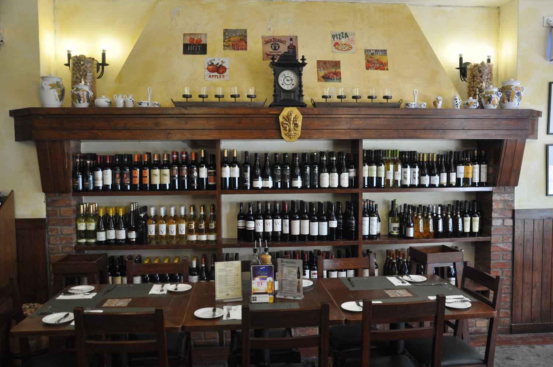 Antica Trattoria Da Isa wine bottles and table