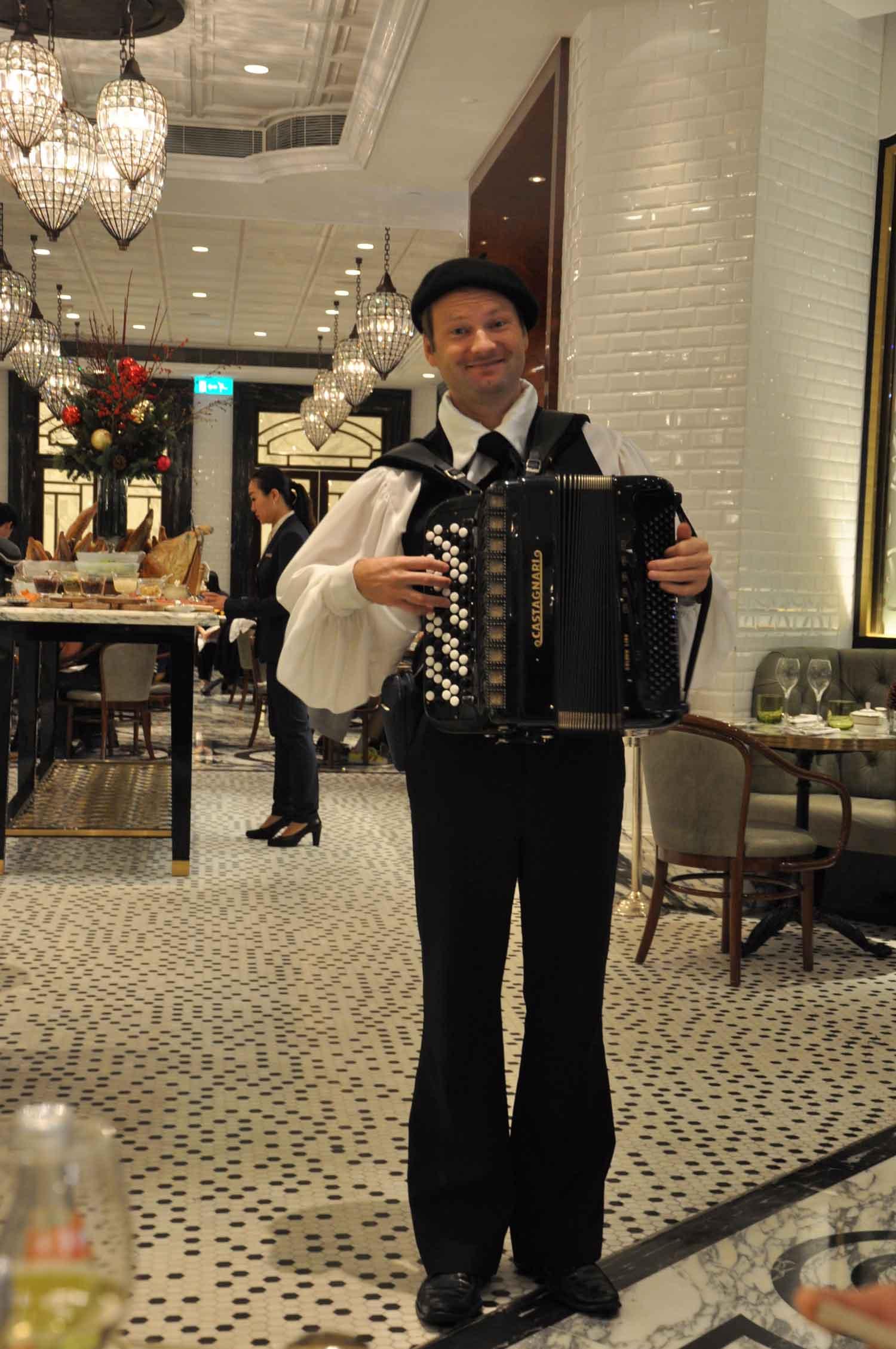 Ritz-Carlton Cafe Macau accordian player