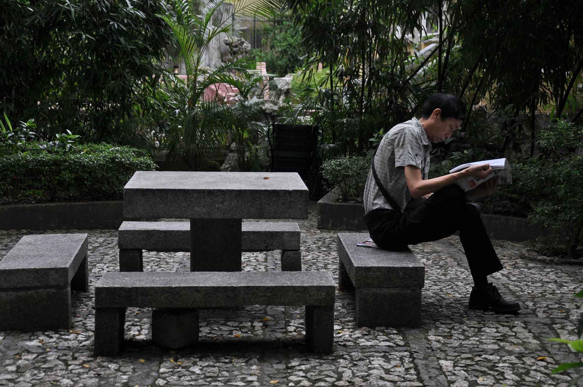 Lou Lim Ieoc Garden man reading