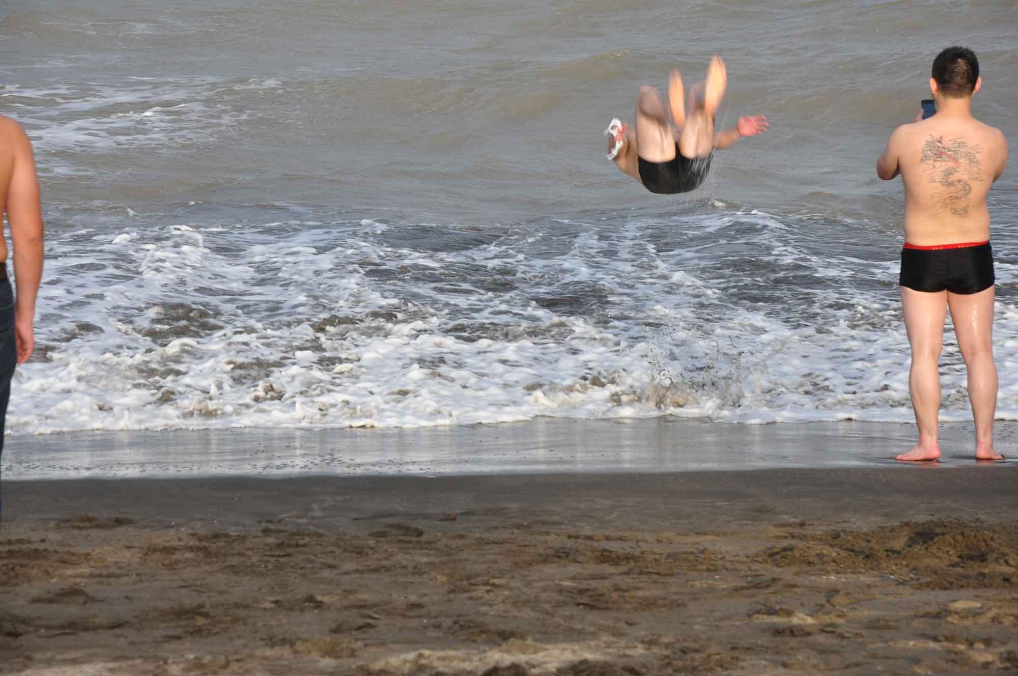 Hac Sa Beach Macau man doing overhead flip