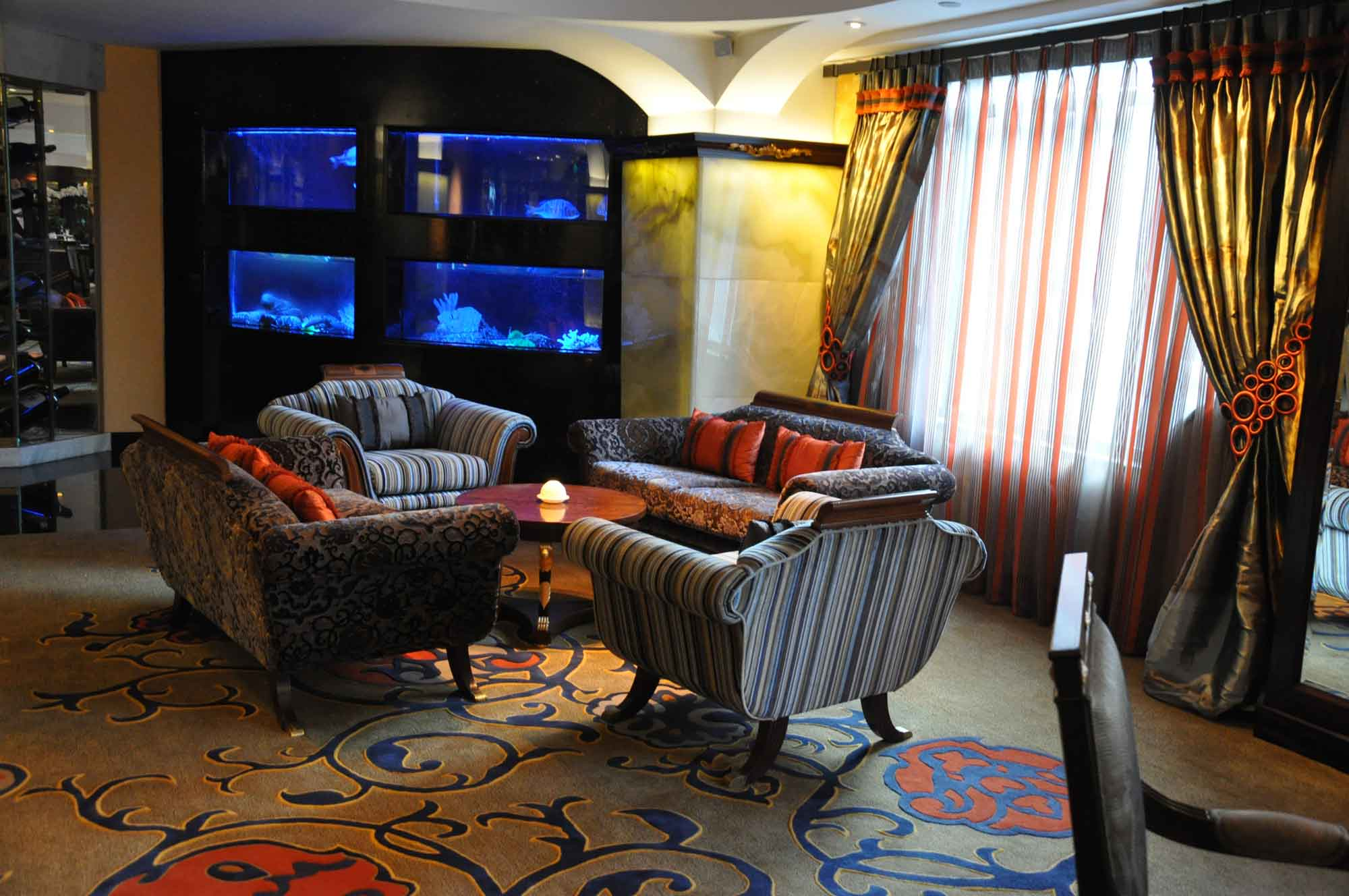 Guincho A Galera Macau lounge section with fish tanks