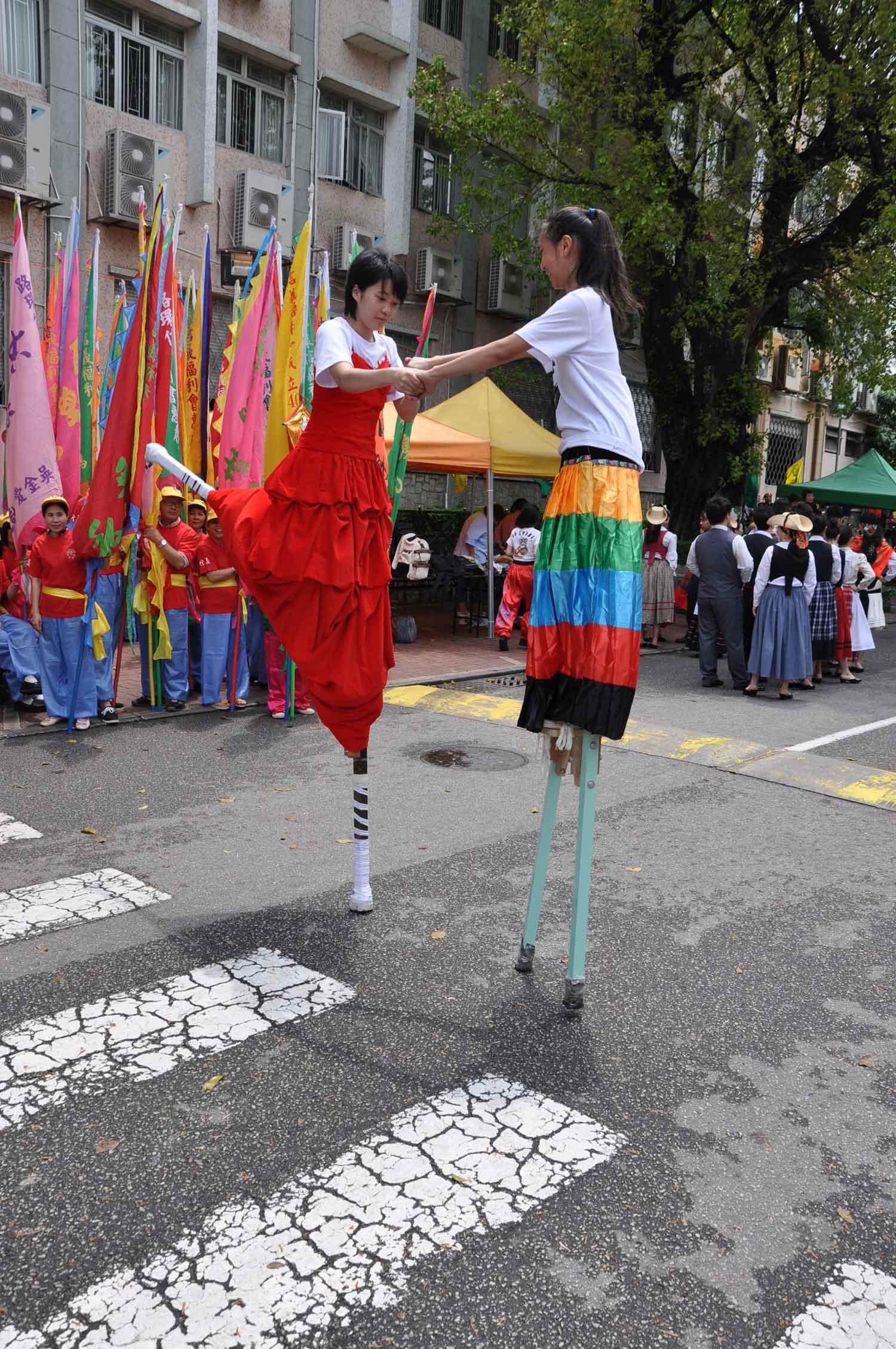 Tam Kong Festival two stilt walkers dancing