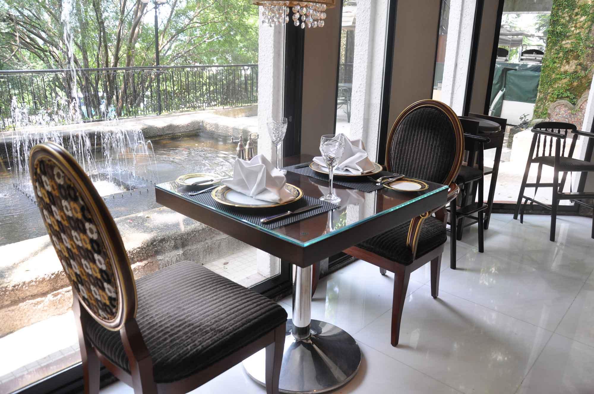 La Paloma Macau table, chair and window