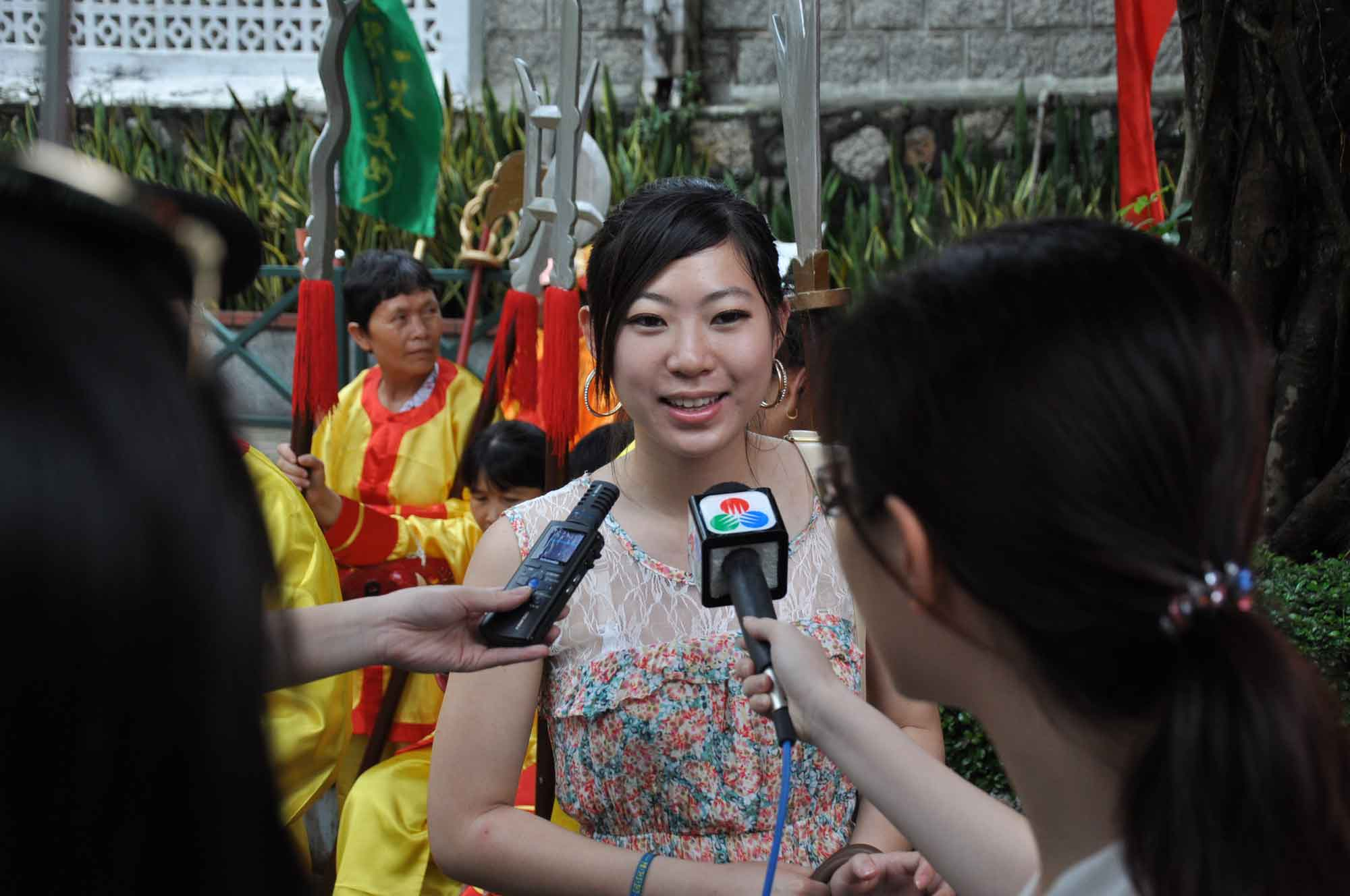 Tam Kong Festival pretty girl interviewed by TV crew