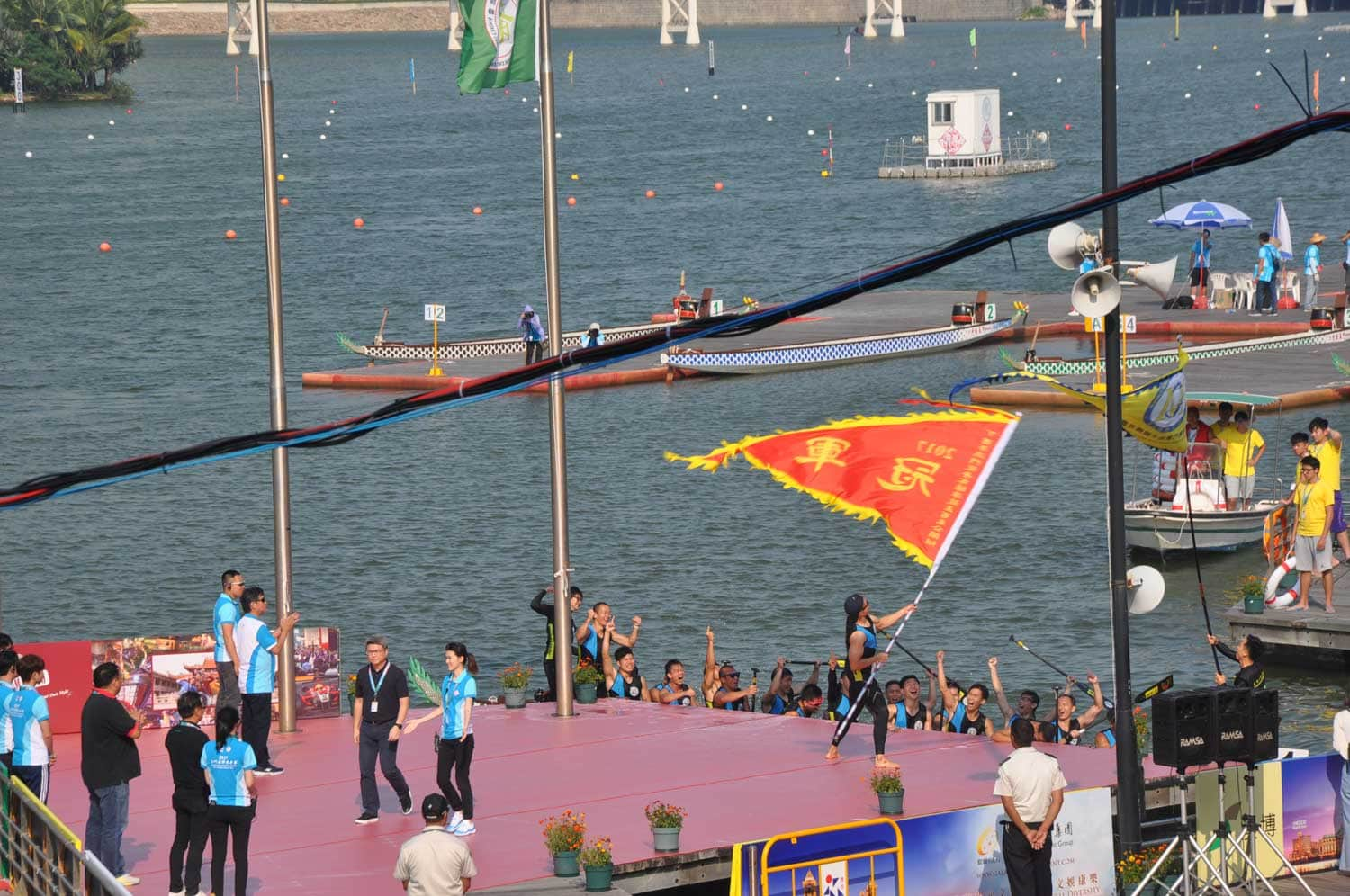 Macau Dragonboat Races victor waiving a flag