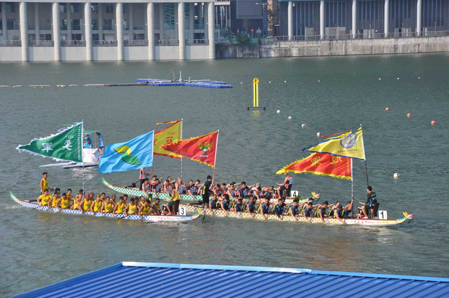 Macau Dragonboat Races dragonboats with flags
