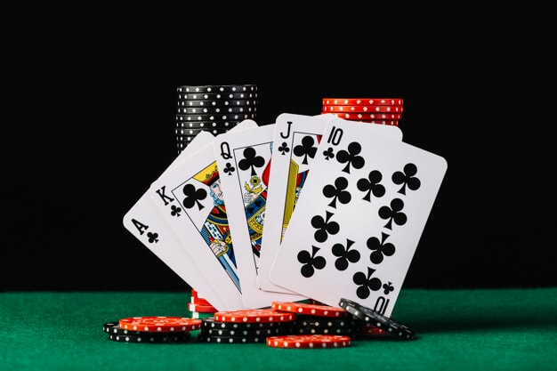 casino-chips-stack-royal-flush-playing-card-green-poker-table_23-2147937910