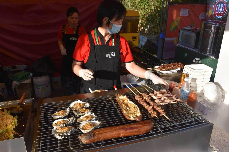 Macau Food Festival woman selling barbecue