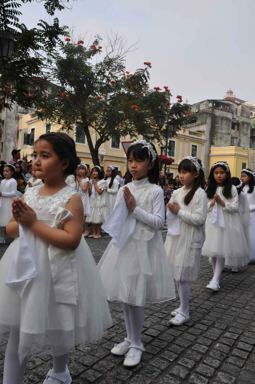 Passion of Our Lord Procession young girls in white dresses