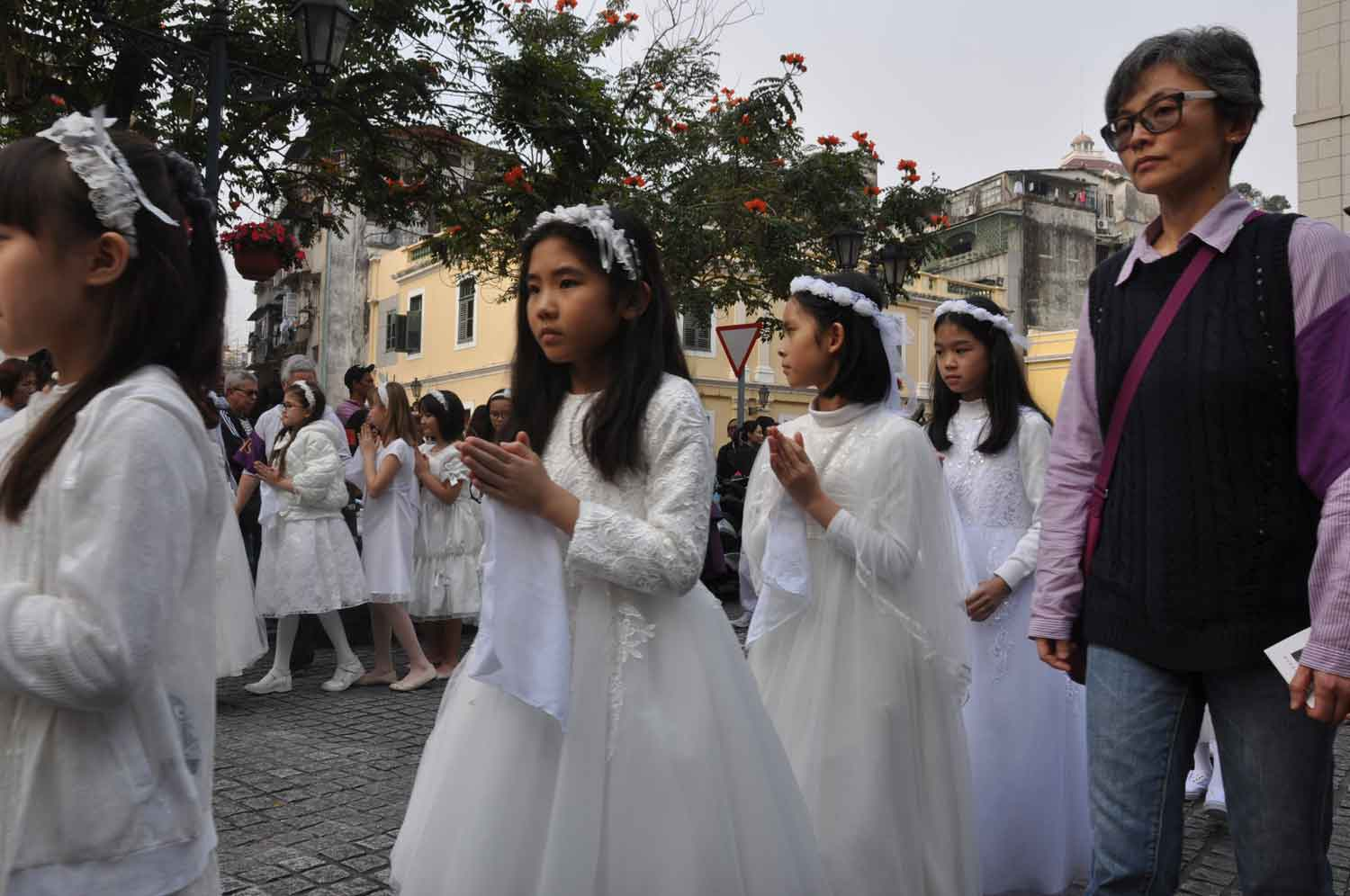 Passion of Our Lord Procession young girls in white outside of Cathedral