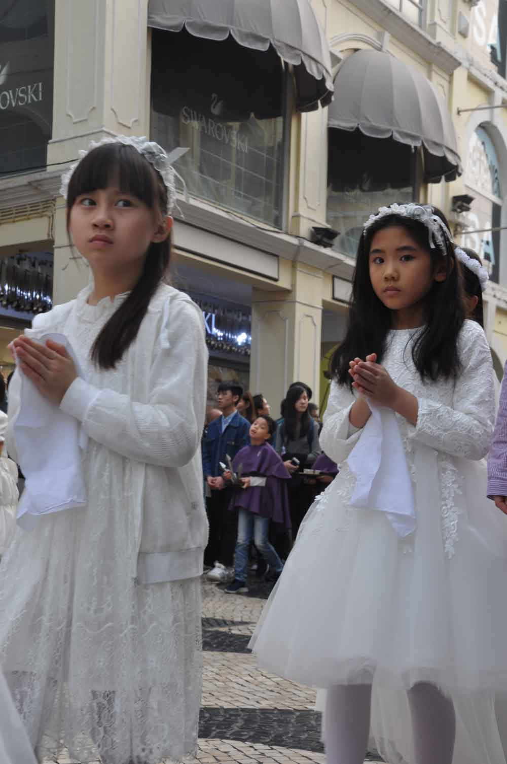 Passion of Our Lord Procession two girls in Senado Square